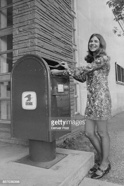 Something New In Denver Cheryl Lorenz of the Denver Convention and Visitors Bureau mails a letter in one of the new pedestal mail boxes being...