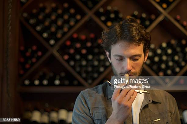 Sommelier sniffing wine cork