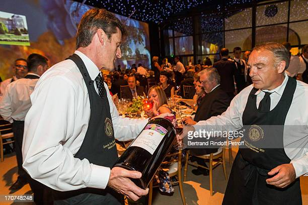 Sommeliers bring the wine for the guests during the dinner of Conseil des Grand Crus Classes of 1855 hosted by Chateau Mouton Rothschild on June 16...