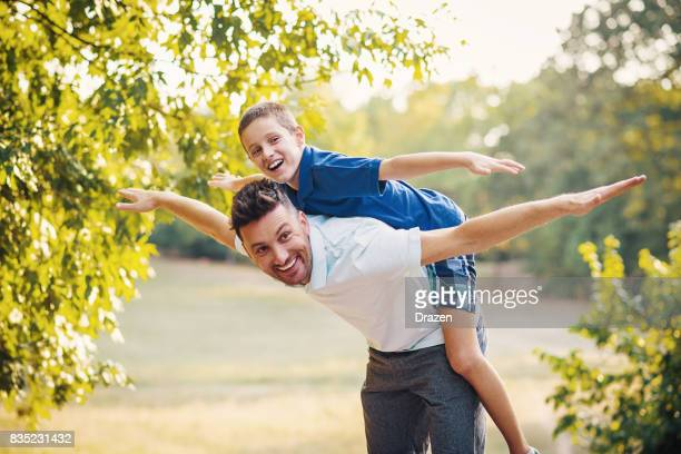 Son and dad doing piggyback