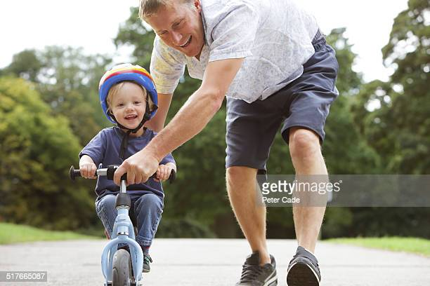 son and dad learning to cycle