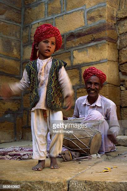 Son Dancing While Father Drums