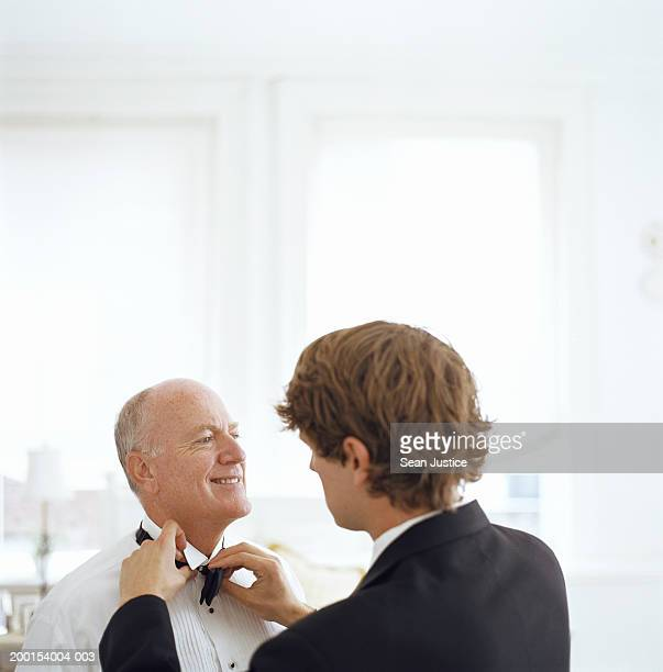 Son fixing father's tie before wedding