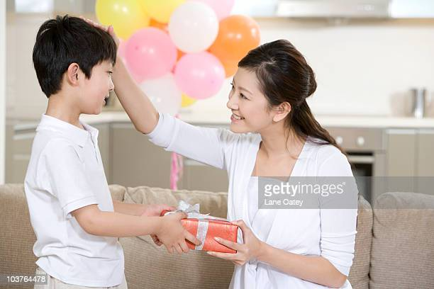 Son gives mother a present