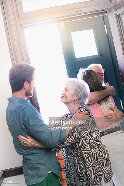 Son greeting mother in hallway