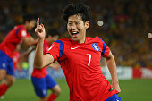 Son Heung Min of Korea Republic celebrates scoring an injury time goal to level the scores during the 2015 Asian Cup final match between Korea...