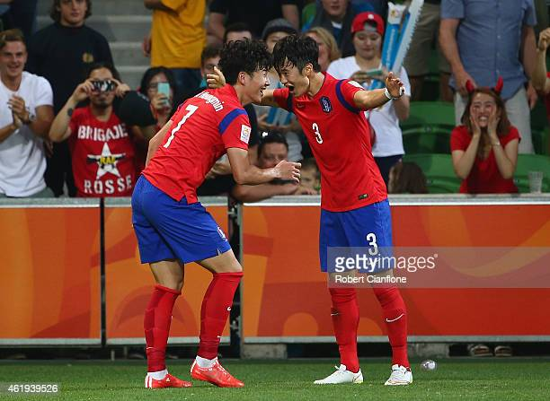 Son Heung Min of Korea Republic celebrates with Kim Jin Su after he scored in extra time during the 2015 Asian Cup match between Korea Republic and...