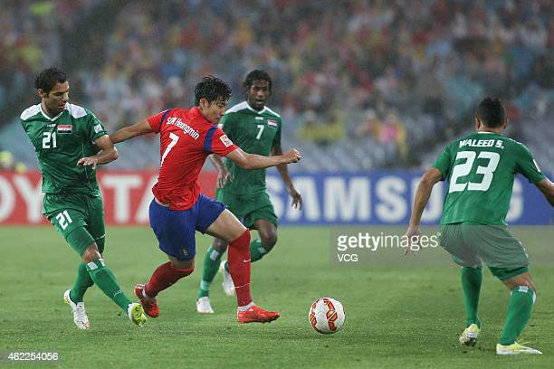 Son Heung Min of Korea Republic competes with Waleed Salim AlLami of Iraq during the Asian Cup Semi Final match between Korea Republic and Iraq at...