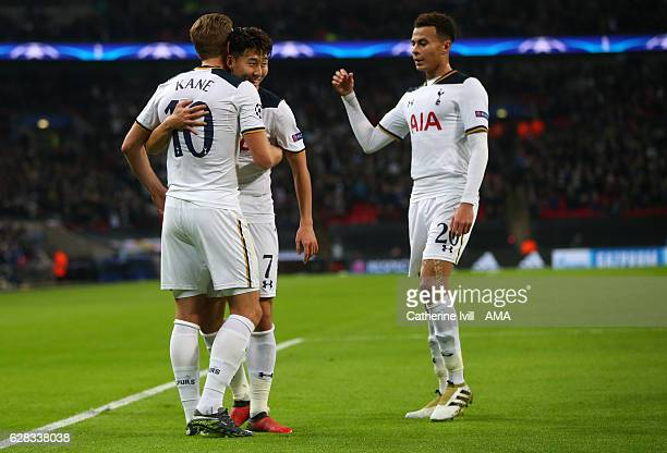 Son Heungmin and Dele Alli of Tottenham Hotspur congratulate Harry Kane of Tottenham Hotspur after he scores to make it 21 during the UEFA Champions...