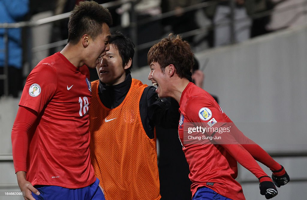 Son Heung-Min calebrates with Kim Shin-Wook of South Korea after score during the FIFA World Cup Qualifier match between South Korea and Qatar at Olympic Stadium on March 26, 2013 in Seoul, South Korea.