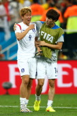 Son HeungMin is consoled by Han KookYoung of South Korea after a 01 defeat to Belgium in the 2014 FIFA World Cup Brazil Group H match between South...