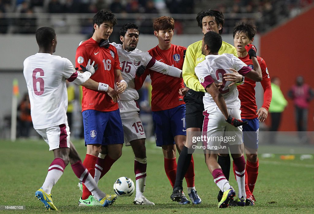 Son Heung-Min, Ki Sung-Yueng and Park Won-Jae of South Korea have an altercation with Hamed Ismail Khaleefa, Bilal Mohammed and Talal Ali Albloushi of Qatar during the FIFA World Cup Qualifier match between South Korea and Qatar at Olympic Stadium on March 26, 2013 in Seoul, South Korea.