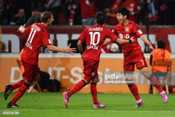 Son HeungMin of Bayer Leverkusen celebrates with team mates Stephan Kiessling and Hakan Calhanoglu as he scores their thrid goal during the...