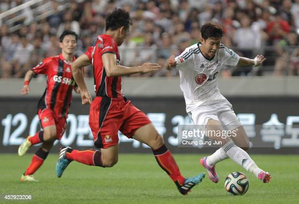 Son HeungMin of Bayer Leverkusen compete for the ball with Lee WoongHee of FC Seoul during the match between Bayer Leverkusen and FC Seoul as a part...