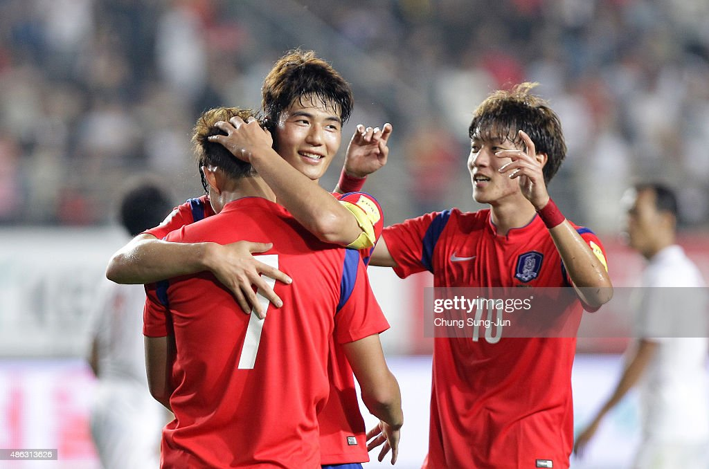 Son Heung-Min of South Korea celebrates with Ki Sung-Yueng after scoring a goal during the 2018 FIFA World Cup Qualifier Round 2 - Group G match between South Korea and Laos at Hwaseong on September 3, 2015 in Hwasung, South Korea.