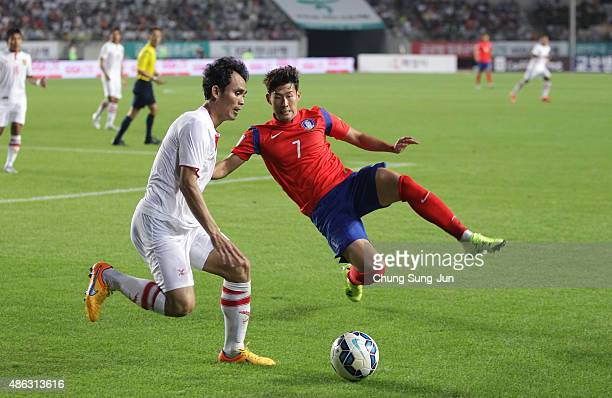 Son HeungMin of South Korea compete for the ball with Hanevila Khamphoumy of Laos during the 2018 FIFA World Cup Qualifier Round 2 Group G match...