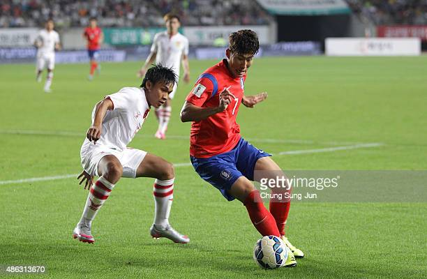 Son HeungMin of South Korea compete for the ball with Souksavath Moukda of Laos during the 2018 FIFA World Cup Qualifier Round 2 Group G match...