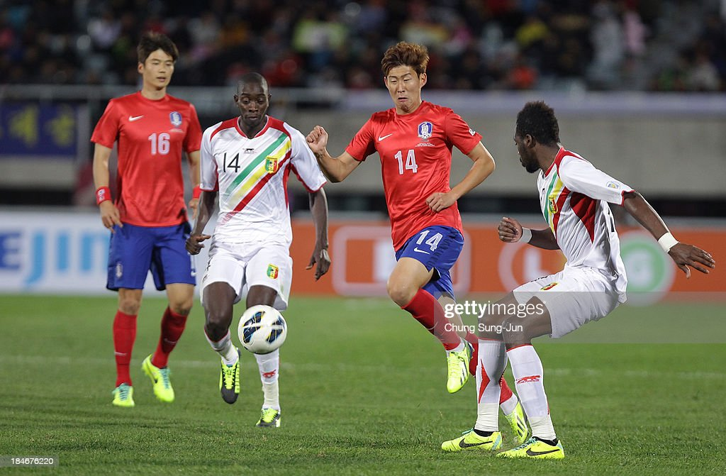Son Heung-Min of South Korea competes for the ball with <a gi-track='captionPersonalityLinkClicked' href=/galleries/search?phrase=Sambou+Yatabare&family=editorial&specificpeople=5747366 ng-click='$event.stopPropagation()'>Sambou Yatabare</a> of Mali during the international friendly match between South Korea and Mali at Cheonan Stadium on October 15, 2013 in Cheonan, South Korea.