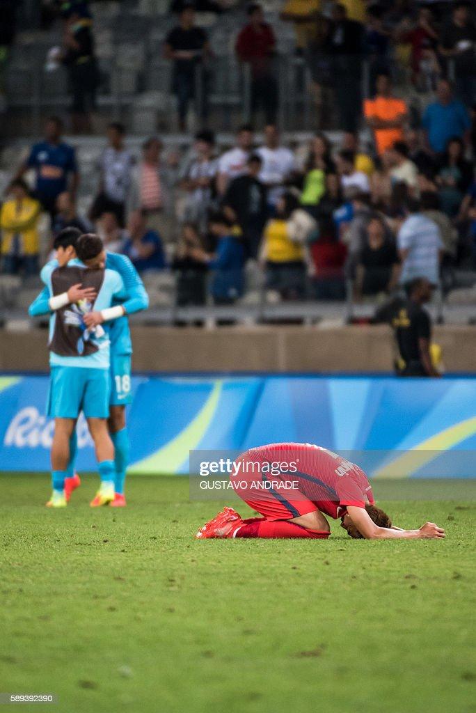 TOPSHOT Son Heungmin of South Korea reacts after the Rio 2016 Olympic Games quarterfinal men's football match Republic of Korea vs Honduras at the...