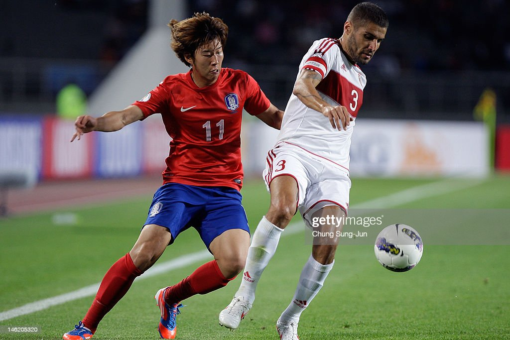 Son Heung-Min of South Korea tussles for posession with <a gi-track='captionPersonalityLinkClicked' href=/galleries/search?phrase=Youssef+Mohamad&family=editorial&specificpeople=787420 ng-click='$event.stopPropagation()'>Youssef Mohamad</a> of Lebanon during the FIFA World Cup Asian Qualifier match between South Korea and Lebanon at Goyang Stadium on June 12, 2012 in Goyang, South Korea.