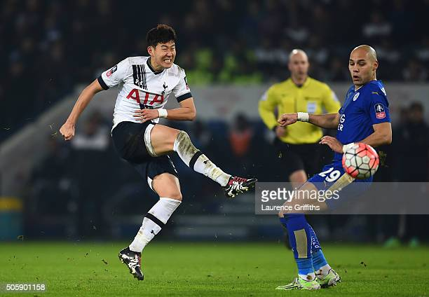 Son HeungMin of Spurs takes a shot on goal past Yohan Benalouane of Leicester City during the Emirates FA Cup Third Round Replay match between...