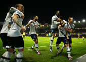Son Heungmin of Tottenham Hotspur celebrates scoring his team's second goal with his team mates during the Barclays Premier League match between...