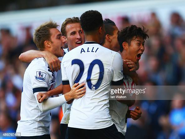 Son HeungMin of Tottenham Hotspur celebrates scoring the opening goal with team mates during the Barclays Premier League match between Tottenham...