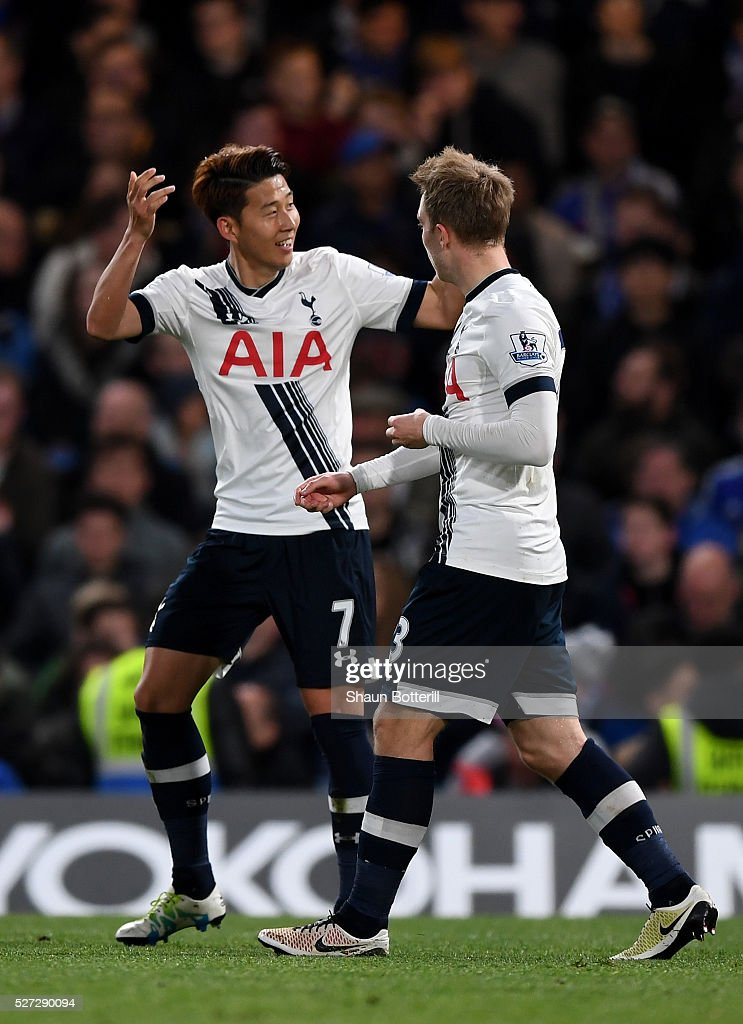 Son Heung-Min of Tottenham Hotspur celebrates with teammate Christian Eriksen (R) after scoring his team's second goal during the Barclays Premier League match between Chelsea and Tottenham Hotspur at Stamford Bridge on May 02, 2016 in London, England.