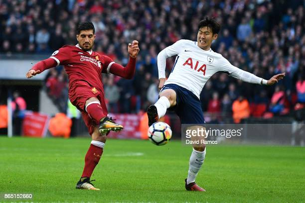 Son HeungMin of Tottenham Hotspur competes for the ball with Emre Can of Liverpool during the Premier League match between Tottenham Hotspur and...