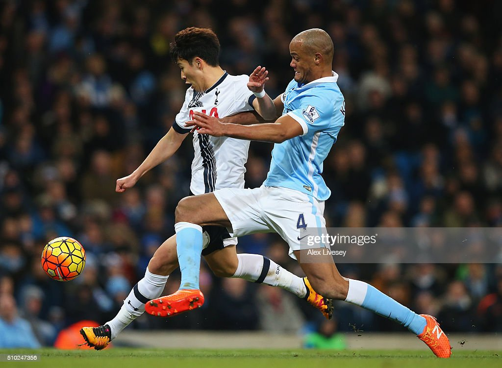 Son Heung-Min of Tottenham Hotspur is challenged by <a gi-track='captionPersonalityLinkClicked' href=/galleries/search?phrase=Vincent+Kompany&family=editorial&specificpeople=504694 ng-click='$event.stopPropagation()'>Vincent Kompany</a> of Manchester City during the Barclays Premier League match between Manchester City and Tottenham Hotspur at Etihad Stadium on February 14, 2016 in Manchester, England.