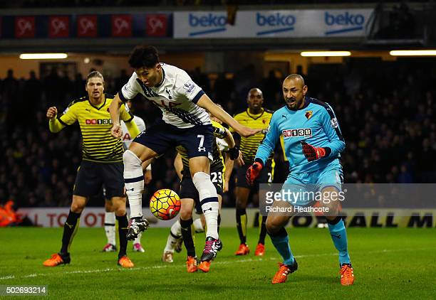Son Heungmin of Tottenham Hotspur scores his team's second goal during the Barclays Premier League match between Watford and Tottenham Hotspur at...