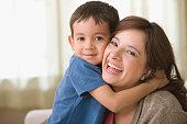 Son hugging smiling mother