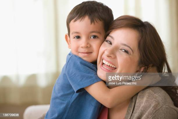Son hugging smiling mother