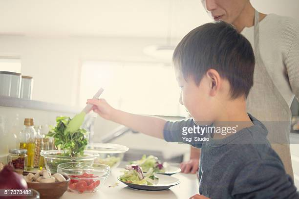 Son is Serve the salad together the father
