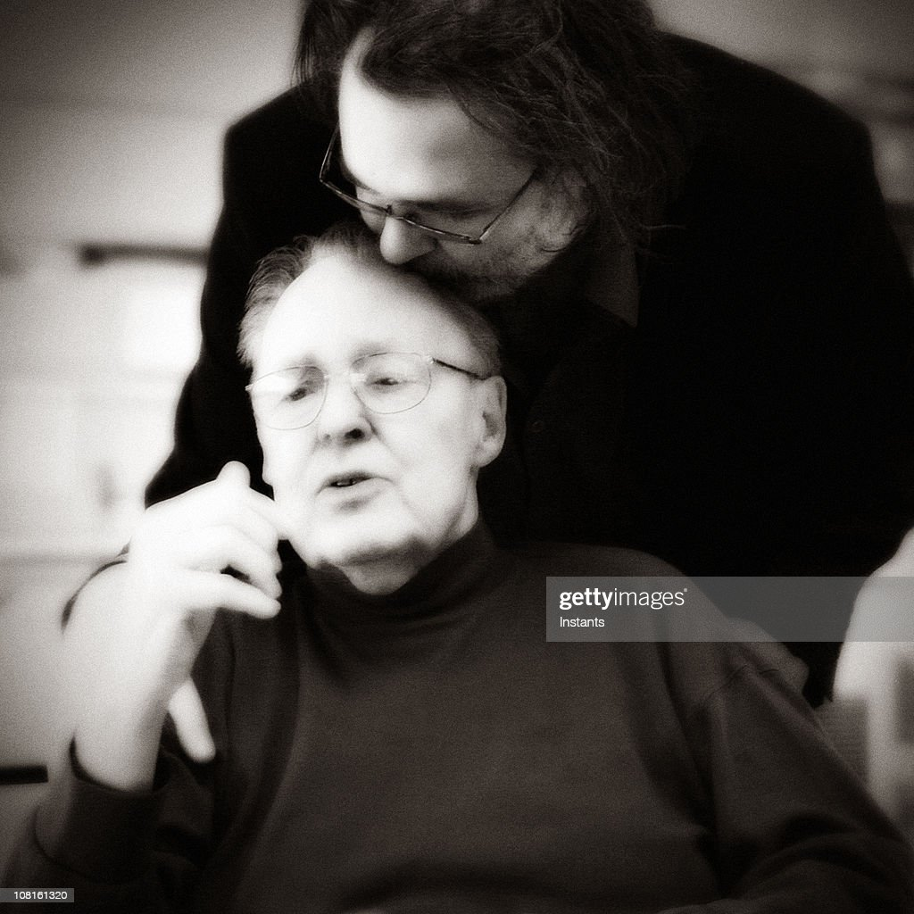 Son Kissing Senior Father on Head : Stock Photo