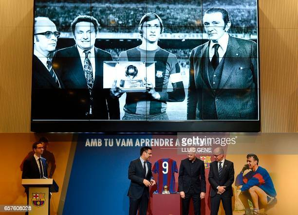 Son of late Dutch football star Johan Cruyff Jordi Cruyff poses with Barcelona's president Josep Maria Bartomeu and Barcelona's vice president Jordi...