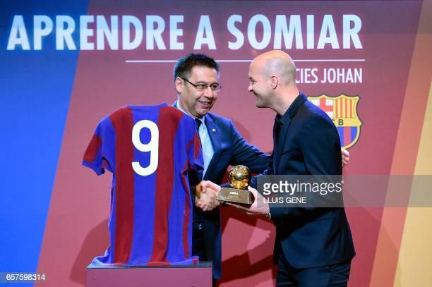 Son of late Dutch football star Johan Cruyff Jordi Cruyff shakes hands with Barcelona's President Josep Maria Bartomeu as he handovers him the...