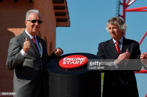 Son of late Italian Ferrari founder Enzo Ferrari Piero Ferrari and the president of PortAventura World Arturo MasSarda gesture past the 'engine...