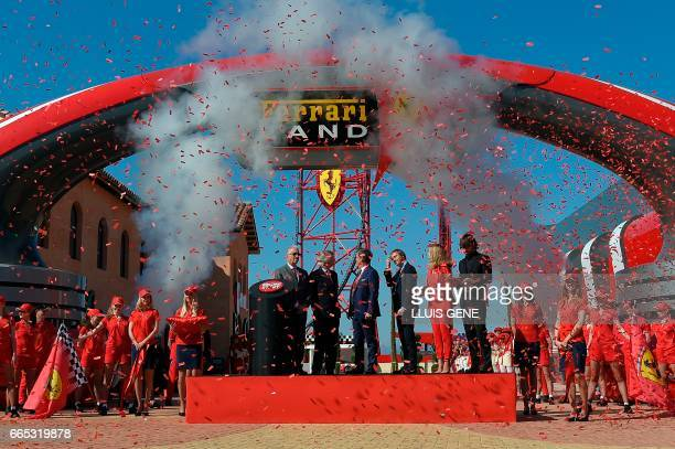Son of late Italian Ferrari founder Enzo Ferrari Piero Ferrari and the president of PortAventura World Arturo MasSarda gesture stand next to the...