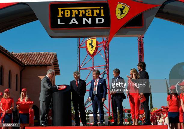Son of late Italian Ferrari founder Enzo Ferrari Piero Ferrari push the 'engine start' button next to and the president of PortAventura World Arturo...