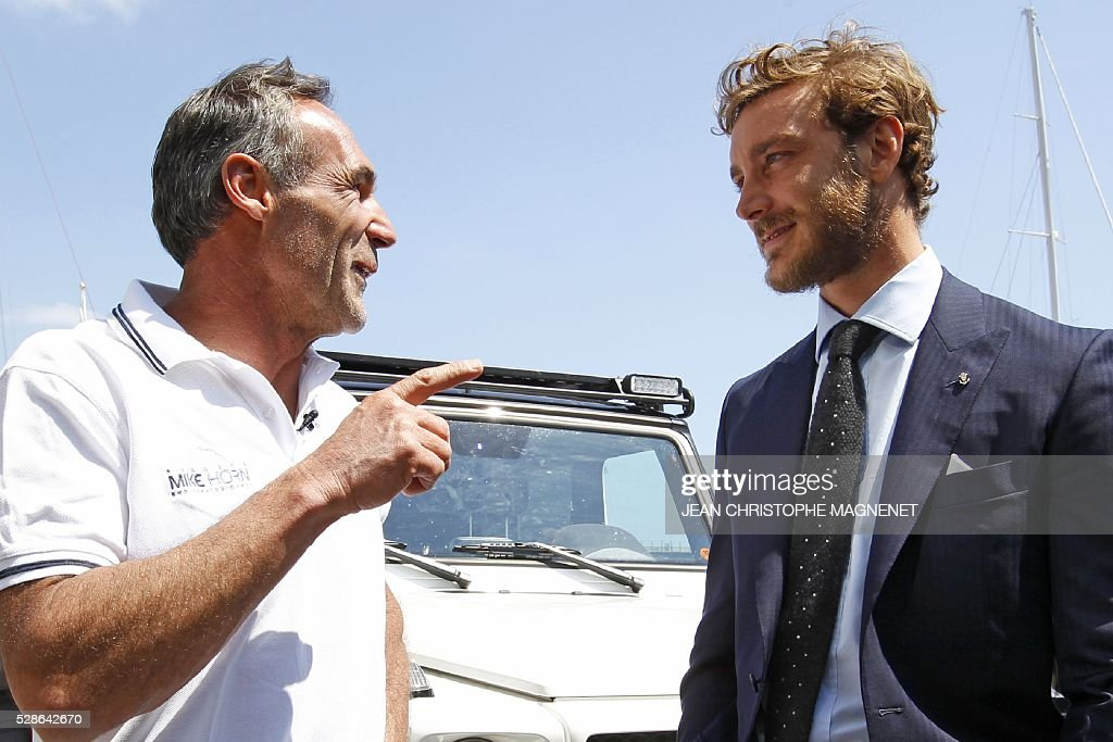 Son of Princess Caroline of Hanover, Pierre Casiraghi (R) speaks with South African and Swiss explorer and adventurer Mike Horn (L), on May 6,2016, in Monaco. Mike Horn will set off from Monaco harbour on May 8, 2016, for his new expedition Pole2Pole to circumnavigate the world via the two poles. / AFP / JEAN