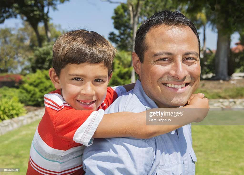 Son on Back Of Father : Stock Photo