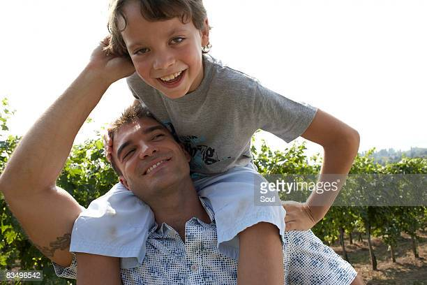 son on father's shoulders