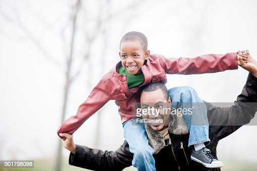 Son Riding on His Father's Shoulders
