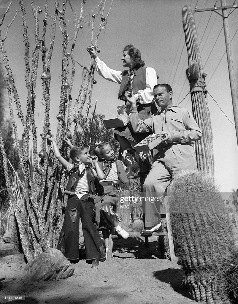 ALLEN -- (l-r) Son Ronnie Burns, Sandra Burns, Gracie Allen, George Burns decorate for Christmas in the cactus garden of Hotel El Mirador in Palm Springs, CA -- Photo by: NBC/NBCU Photo Bank