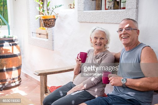Son Taking Coffee With Her Senior Mother : Photo