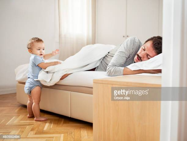 Son waking father