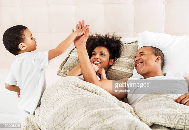 Son waking up his parents in the morning.