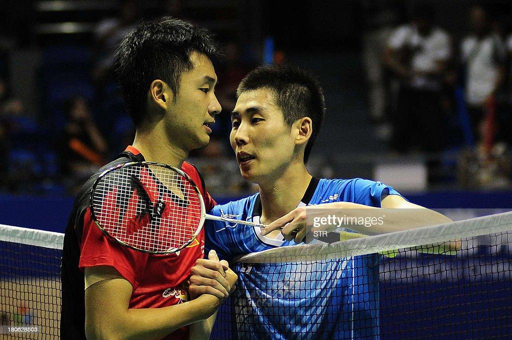 Son Wan Ho (R) of South Korea congratulates Wang Zhengming of China during the men's singles final match of the 2013 China Masters in Changzhou, east China's Jiangsu province on September 15, 2013. Wang won 11-21, 21-14, 24-22. CHINA