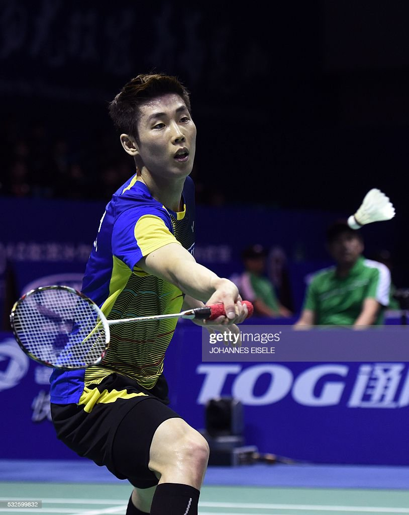 Son Wan Ho of South Korea hits a return against Cheng Long of